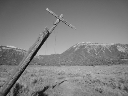 "Remnants of the old telephone poles and lines remain in Horse Gulch and continue over ""Telegraph Pass"" to the east--not telegraph poles."