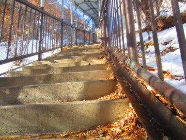A steel ledge could be welded along the edge of the stairs at Purgatory Village to facilitate the pushing of bikes from the ticket office area to the top where the lifts are located. This picture shows a similar device on the stairs next to the swinging bridge behind the Discovery Museum in Durango.
