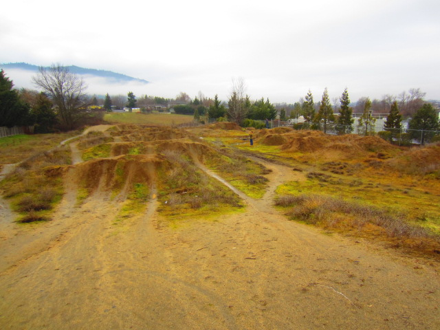 Here's a dirt jump park by the Greenway bike path in Ashland, Oregon. Too muddy to ride on this day.