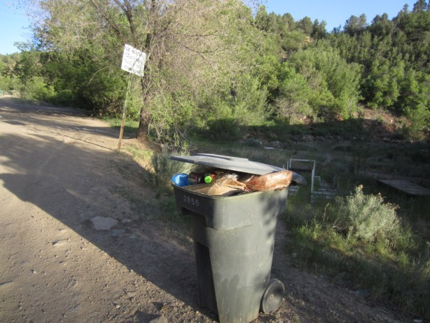 A City-owned trash can at Horse Gulch trail head is maxed out to the limit last summer.