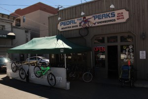 You can find Pedal The Peaks on the south side of College near the corner with Main Ave.