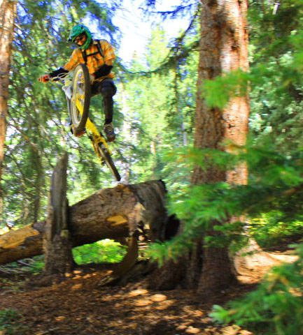 That's Nate Kirker hitting a big booter on a freeride trail in the San Juans.