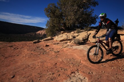 A broad sandstone face running along the lower part of Sand Canyon makes for some good times on a mountain bike.