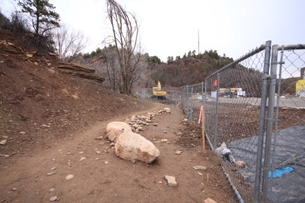 Security fencing at Horse Gulch trail head restricts people to a slower speed, for safety reasons, as there is a lot of construction-related traffic on the road below.