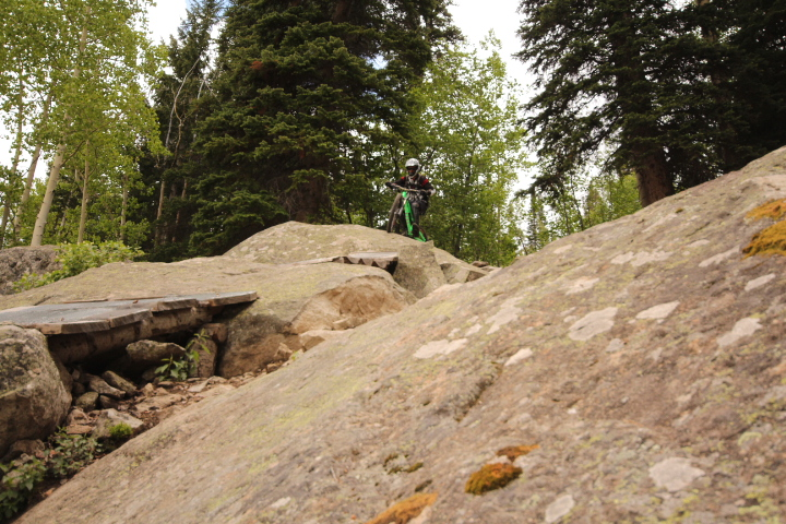 Rider Adam Howell on Psycho Rocks Trail at Evolution Bike Park.