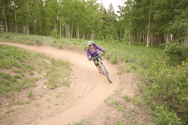 Rider Emily Koren on one of the many grin-inducing berms of Awakening Trail at Evolution Bike Park.