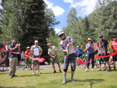 Purgatory's Trail Manager Josh Hamill cuts the ribbon at the grand opening of the Divinity Downhill Flow Trail.