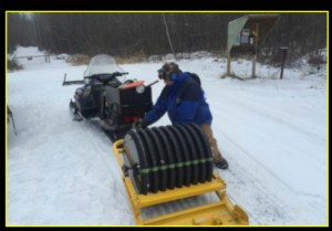 This is what the snow machine with the tow-behind groomer looks like.