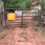 This gate is on the Bronson's property at the base of Falls Creek Road off of County Road 203. It is easy to walk around and does not attempt to interfere with access by the general public.