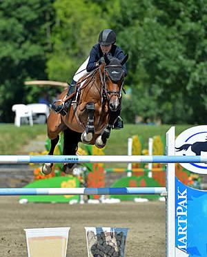 With Wings Flies Karen Polle to a Birthday Win in the $25,000 SmartPak Grand Prix at HITS Saugerties