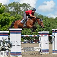 ©ESI Photography. Manuel Torres and Fidelina on their way to a win in the $15,000 Brook Ledge Open Jumper Prix