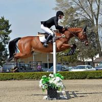 ©ESI Photography. Melissa Rudershausen wins the $10,000 Bayer's Legend Junior/Amateur-Owner High Jumper Classic with Charmeur Ask.