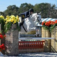 (c) ESI Photography. Kimberly Maloomian and Urlala jump to win the $1,500 Platinum Performance Hunter Prix.