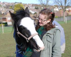 Dr Leanne Proops makes a friend of one of the horses