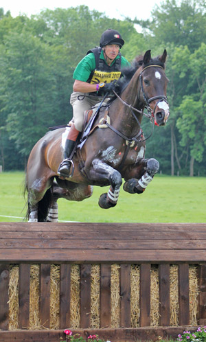 Carl Bouckaert and Cyrano Z over the eighth fence at Bramham.