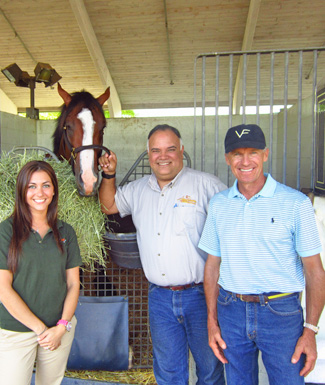 Stacey West with the horse Union Rags, Luis Castro, and trainer Michael Matz. Union Rags, winner of the 2012 Belmont Stakes leg of the Triple Crown, was stabled at Palm Meadows Training Center, a major thoroughbred training center used by more than 1200 horses during the winter months.