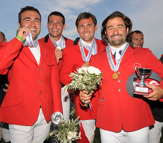 The Turkish team of (L to R) Husnu Dinc, Cagri Basel, Hasan Senturk and Horasan Sencer celebrate their victory in the Senior Team event at the FEI Balkan Jumping Championships in Athens, Greece over the weekend.