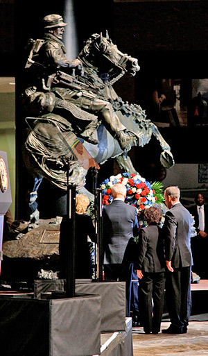 Vice President Joseph Biden and his wife, Dr Jill Biden, join Mr and Mrs Whiting, parents of a fallen 5th Special Forces Group (Airborne) Green Beret, as they lay a wreath in front of the De Oppresso Liber statue during the dedication and unveiling ceremony for the statue at the Winter Garden Hall in Two World Financial Center near Ground Zero. © Staff Sgt. Andrew Jacob
