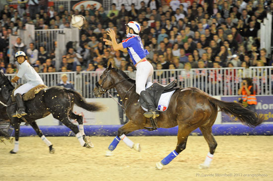 A French rider reaches for a pass in the team's game against Argentina yesterday.