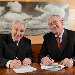 NIHB Chairman Samuel J.Smyth, left, and HSI CHairman Joe Walsh, sign the affiliate papers this week in Dundalk, Co. Louth.