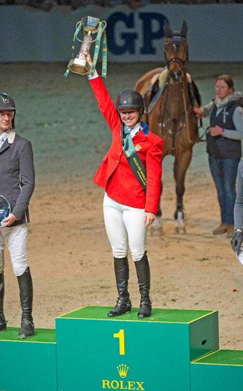 The USA's Beezie Madden holds the trophy aloft after her sensational victory with Simon at the Rolex FEI World Cup Jumping Final in Gothenburg, Sweden.