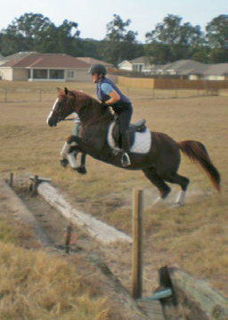 Helen and Stat schooling over a ditch in 2008.
