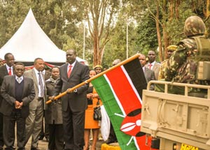 The Principal Secretary for Environment, Water and Natural Resources Dr. Richard Lesyiampe, flags off part of the Elite Inter-Agency Anti-Poaching Unit at the KWS headquarters during the launch of the unit. Looking on is  David Mwiraria, KWS Board of Trustees Chairman, left, and the Ministry of Environment, Water and Natural Resources, Conservation Secretary, Mr Gideon Gathaara, centre.