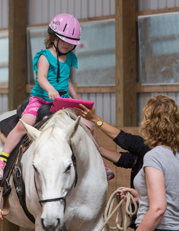 Equine therapy and assistive technology  have been proven effective independently, but have rarely been used in tandem.