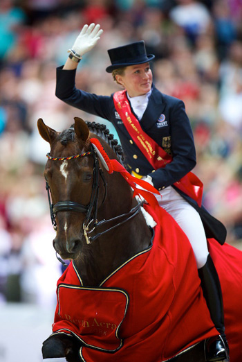 Germany's Helen Langehanenberg and Damon Hill NRW celebrate their victory in the Reem Acra FEI World Cup™ Dressage Final 2013.