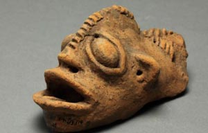 A figurine appearing to depict a combined human and animal head. Photo: University of Manchester/University of Ghana