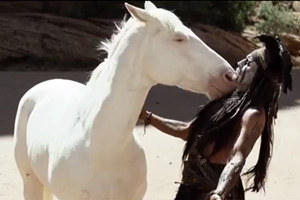 Johnny Depp as Tonto in a scene with Silver from the film.
