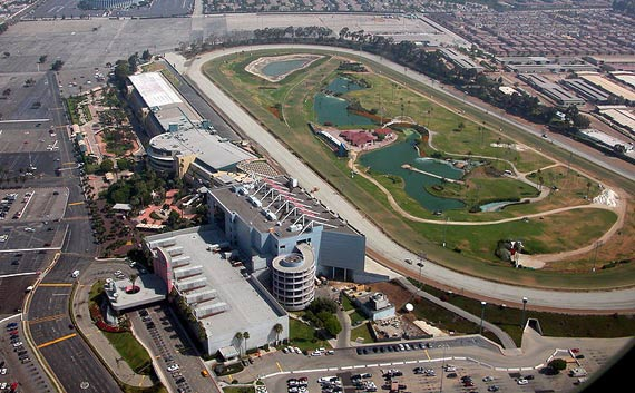 Hollywood Park Racetrack in Inglewood, California, is about 10 miles south of Hollywood.   The Forum, a round indoor arena, is upper left.