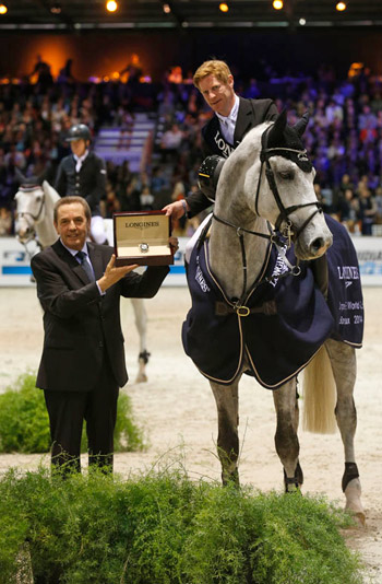Marcus Ehning receives his prize of a Longines watch from Alain Henry, Longines France after winning the latest World Cup leg, at Bordeaux at the weekend with Cornado NRW.