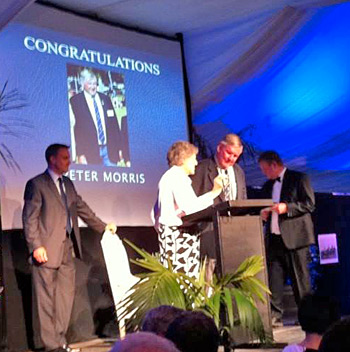 Volunteer Lifetime Award recipient Peter Morris receives the Pilmer Plate.