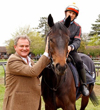 Hugh Bonneville with his horse Gothic at Sir Michael Stoute's yard in Newmarket.