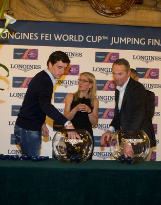Conducting the draw for order-of-go in the first leg of the Longines FEI World Cup Jumping Final were Belgium's Nicola Philippaerts, left, and  French rider Patrice Delaveau.