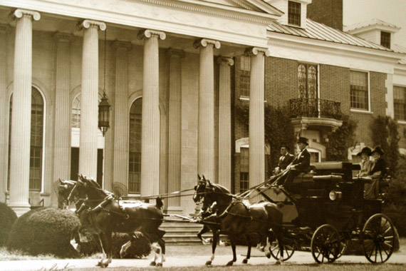 A carriage leaves Spindletop Farm during its heyday.