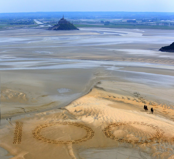 Giant 2.3m by 2.5m horse hoof prints created in the Bay of Mont-Saint-Michel, the famous UNESCO World Heritage Site, by French artist and sand sculptor Christophe Dumont, mark 100 days to the start of the Alltech FEI World Equestrian Games 2014 in Normandy, France.