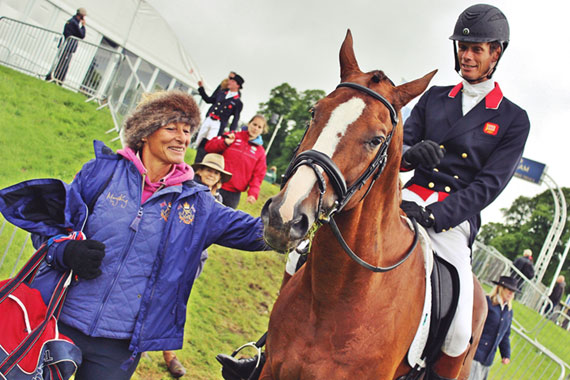 Mary King congratulates former ride Chilli Morning and William Fox-Pitt after they took the lead in the dressage phase of the CIC3*.