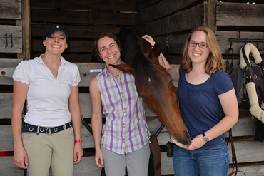 From the right, Jane Withstandley, New Bolton Center Drs. Amy Johnson and Joy Tomlinson, and Calvin, at the Devon Horse Show stables.
