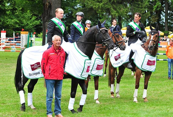 The winning German team at Strzegom (POL), fourth leg of the FEI Nations Cup 2014 (mounted, left to right): Michael Jung, Sandra Auffarth and Dirk Schrade with their chef d'equipe Hans Melzer.