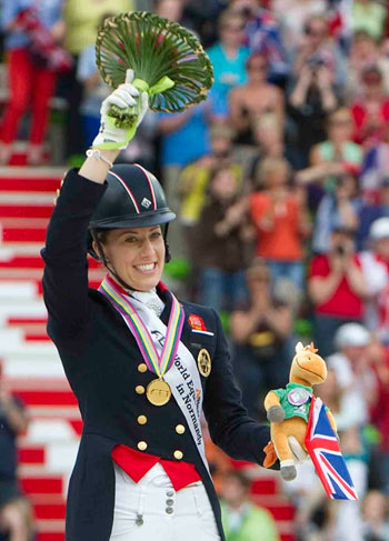 Charlotte Dujardin on the podium after her freestyle win.