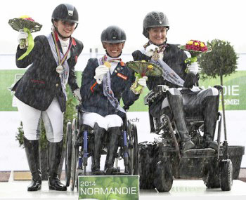 Grade II gold medalist Dutch rider Rixt van der Horst, with silver and bronze medalists Natasha Baker and Lauren Barwick.