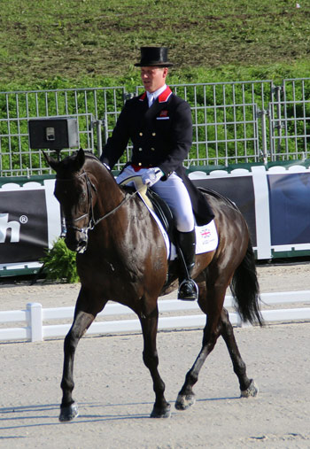 Britain's Oliver Townend and the New Zealand bred thoroughbred, Black Tie, who finished the dressage in 21st place.