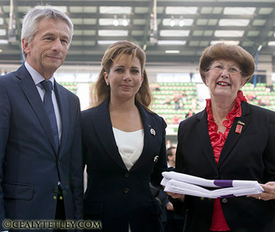 Chairman of the Organizing Committee of the Alltech FEI World Equestrian Games 2014 and President of the Lower Normandy Region,  Laurent Beauvais, with FEI President Princess Haya, and Pauline Quinlan, Mayor of Bromont at the handover ceremony.