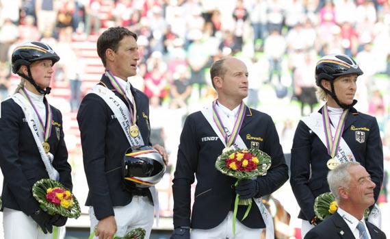 Germany's gold medal winning team, from left, Sandra Auffarth, Dirk Schrade, Michael Jung, and Ingrid Klimke.