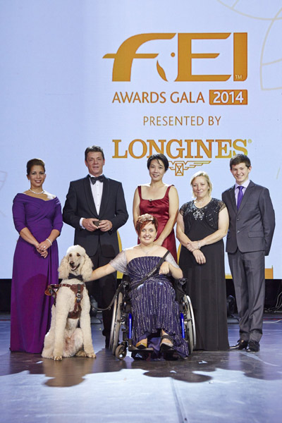 """Equestrian heroes were celebrated tonight at the glittering FEI Awards 2014, the """"Oscars of the equestrian world"""", presented by Longines in Baku's fabulous Buta Palace (left to right): HRH Princess Haya, Jeroen Dubbeldam (NED), Melissa Tan (SIN) chairman of equine therapy centre Equal Ark, Jackie Potts (GBR), Lambert Leclezio (MRI) with (centre) Sydney Collier (USA) and her service dog Journey. © FEI/Liz Gregg"""
