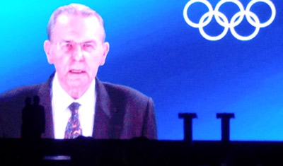 A video tribute from Jacques Rogge plays as Princess Haya and her brother Prince Ali look on.