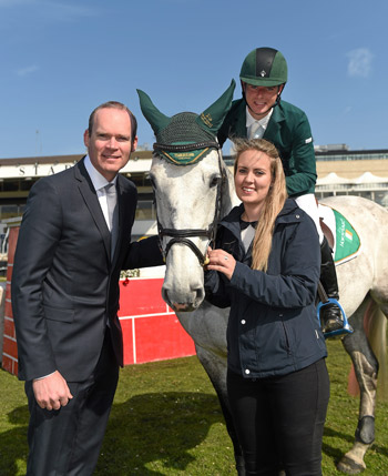 Edward Butler, on CSF Whiterock Cruise, with Ireland's Agriculture Minister Simon Coveney and Sophie D'Alton of Horse Sport Ireland at the launch of 'Jumping In The City'  at Shelbourne Park in Dublin.