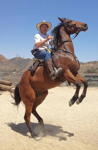 "Colin Dangaard pictured on his horse, Ringo. ""Somebody gave him to me because he reared. So I decided to not only let him do that but encourage him. He now rears beautifully on demand , can even walk backwards. It is nothing I taught him. He just loves doing it."" Ringo was recently sold to a Hollywood horse handler."